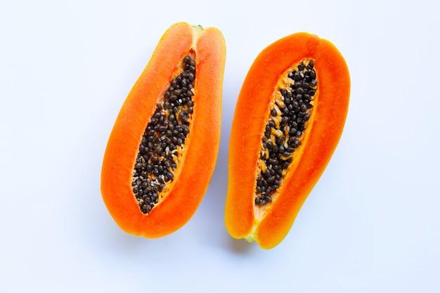 Half of ripe papaya fruit with seeds isolated on white background Premium Photo