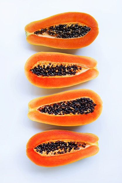 Half of ripe papaya fruit with seeds isolated on white background Premium Photo