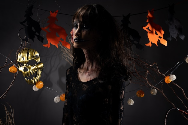 Halloween background with witch pumpkin garland Premium Photo