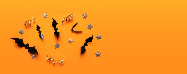 Halloween banner with black but on an orange surface, top view Premium Photo
