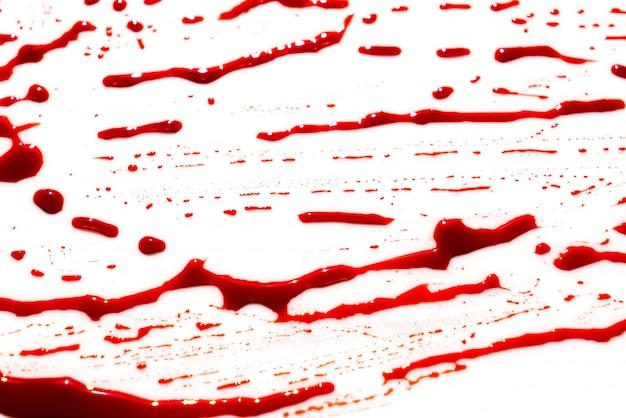 Концепция хэллоуин: кровь брызги на белом фоне. Бесплатные Фотографии