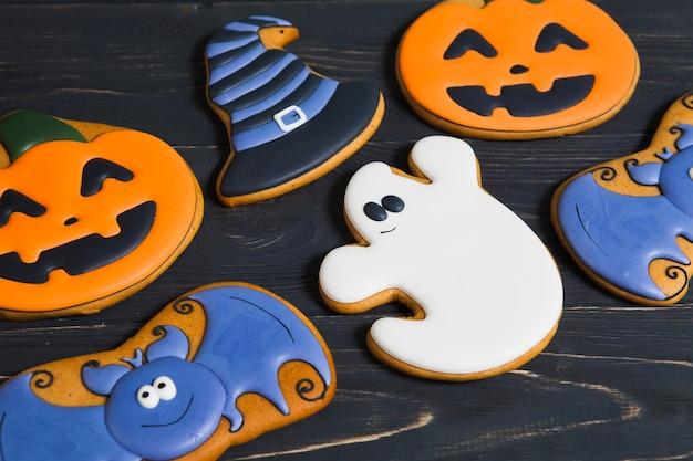 Halloween cookies on wooden table Free Photo