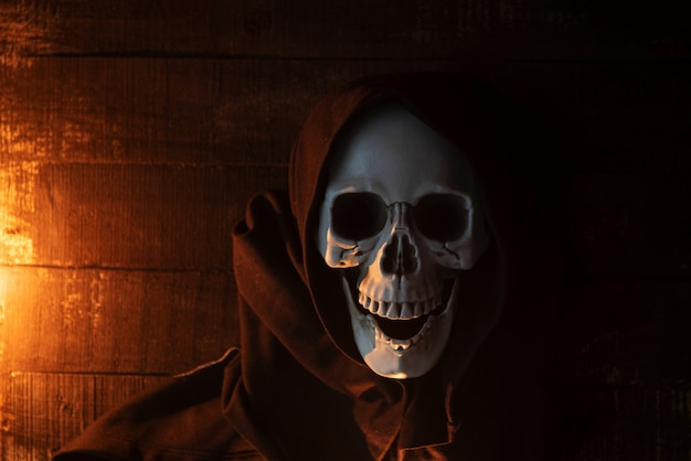 Halloween costume ghost scary skeleton wearing a hooded coat Premium Photo