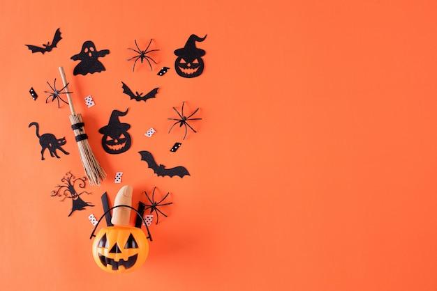 Halloween crafts on orange background with copy space. Premium Photo