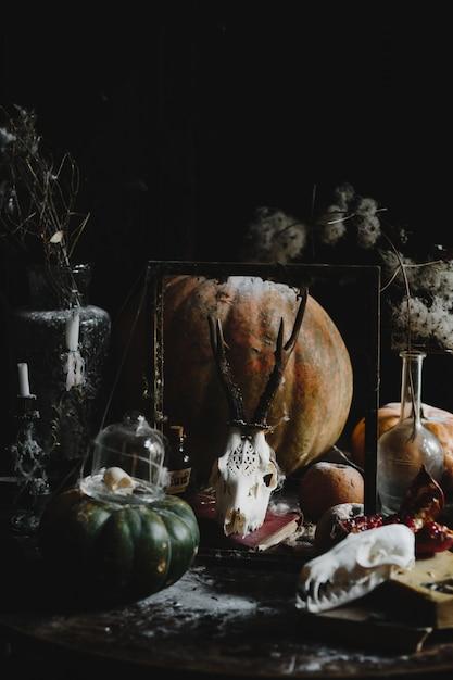 Halloween decor. old pumpkins, pomegranates, apples Free Photo
