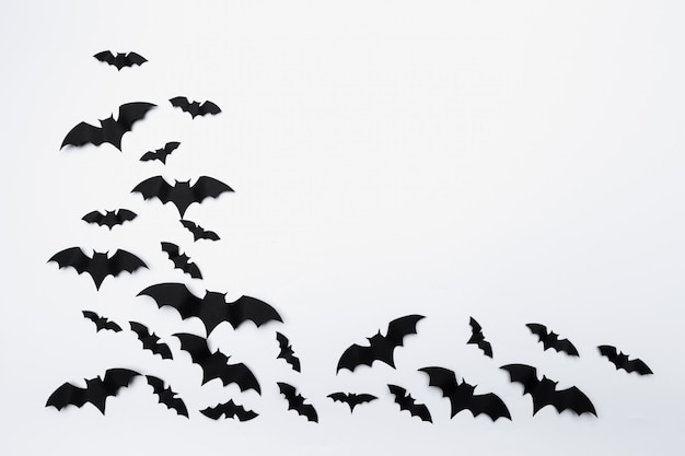 Halloween and decoration concept - paper bats flying background Premium Photo