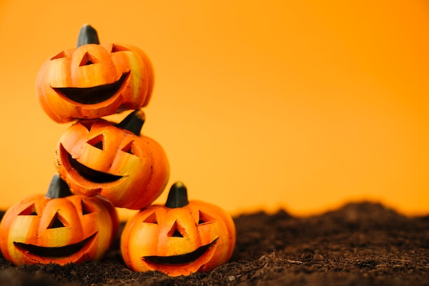 Halloween decoration with laughing pumpkins Free Photo