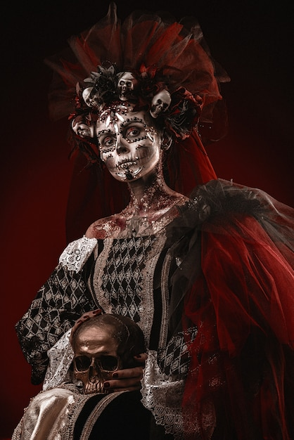 Halloween girl in a death costume Premium Photo