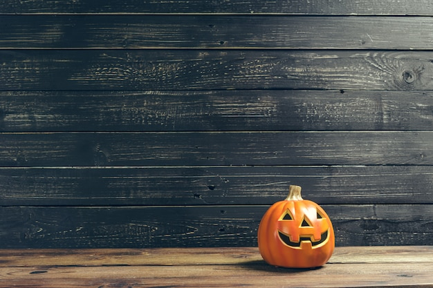 Halloween holiday background with pumpkin on wooden table Premium Photo