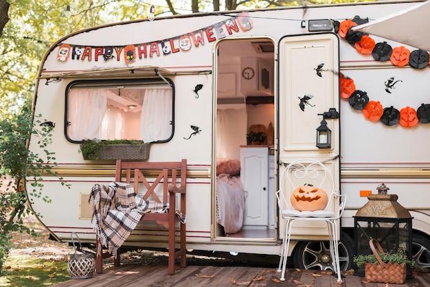 Halloween outdoors arrangement with caravan Free Photo