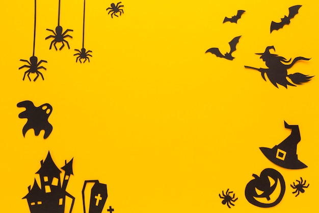 Halloween party elements with orange background Free Photo