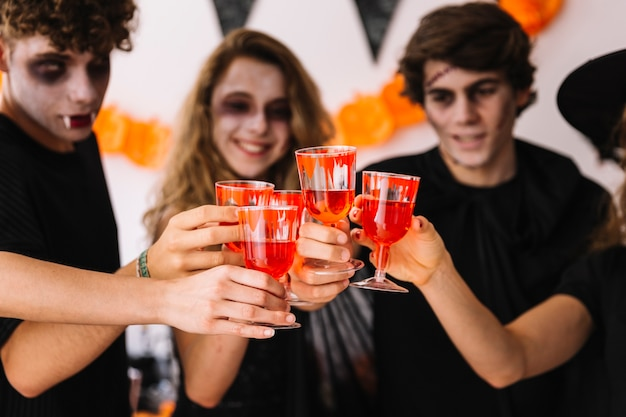 Halloween party with fake blood on glasses Free Photo