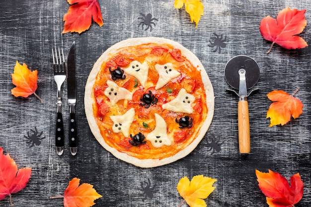 Halloween pizza with creepy ghosts on top Free Photo