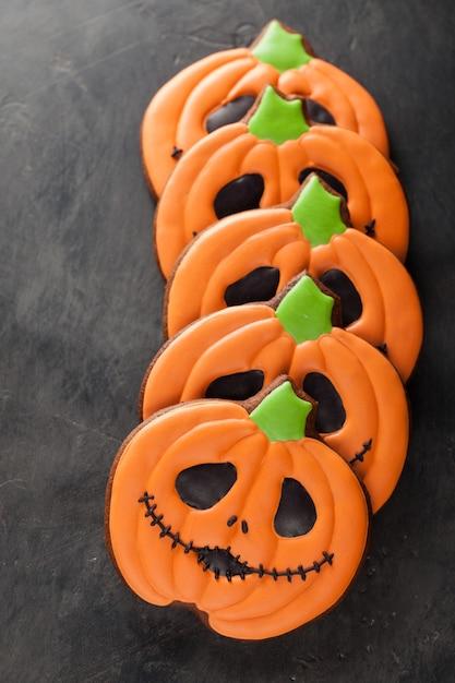 Halloween pumpkin and bats cookies. Premium Photo