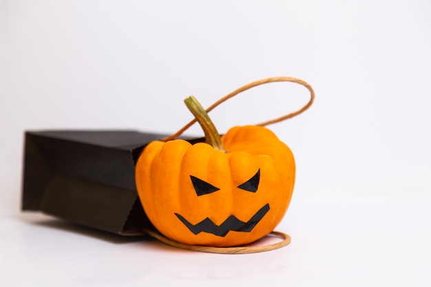 Halloween pumpkin and black paper bag isolated Premium Photo