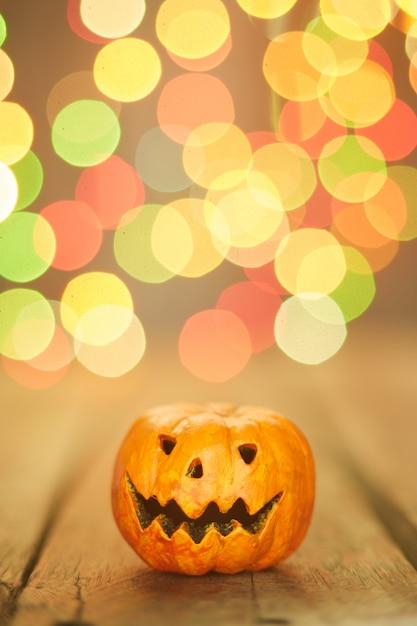 Halloween pumpkin on a bokeh lights background Premium Photo