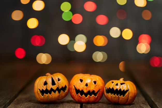 Halloween pumpkin on a bokeh lights background Premium Photo
