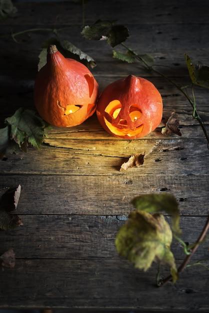 Halloween pumpkin head jack leaves wooden Premium Photo