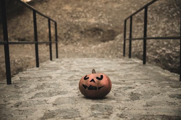 Halloween pumpkin placed on walkways in park Free Photo