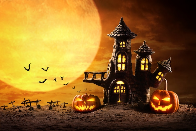 Halloween pumpkins and castle spooky in night of full moon and bats flying Premium Photo