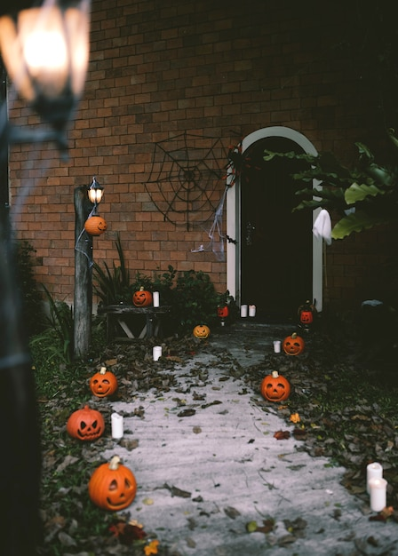 Halloween pumpkins and decorations outside a house Free Photo