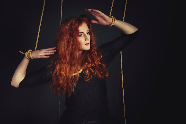 Halloween redhead woman marionette doll Premium Photo