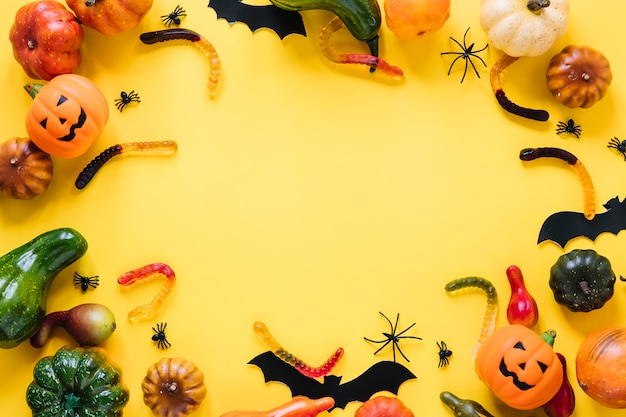 Halloween toys with vegetables and candies Free Photo