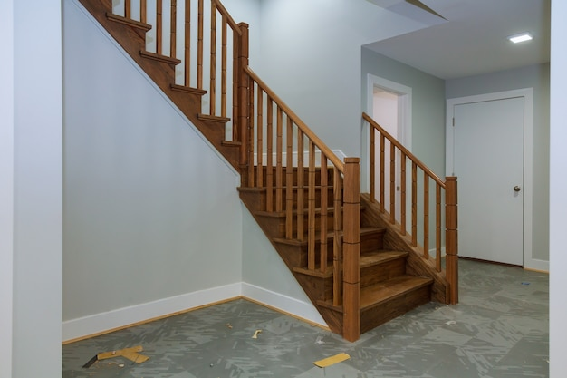 Hallway interior with hardwood floor. view of wooden stairs. Premium Photo