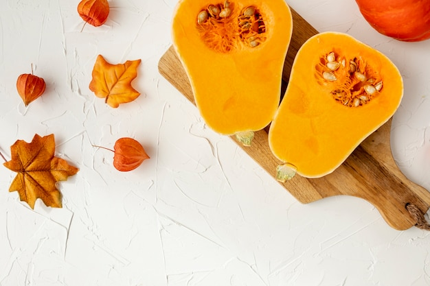 Halved pumpkin on cutting board Free Photo