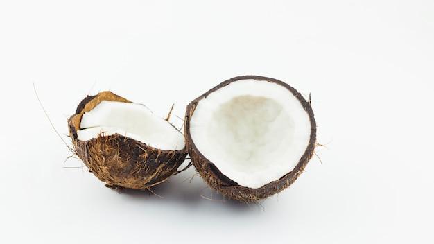 Halves of cracked coconut Free Photo