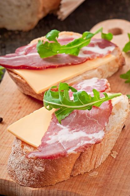 Ham sandwich decorated leaf arugula Free Photo