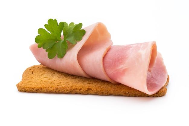 Ham sliced sausage isolated on white background. Premium Photo