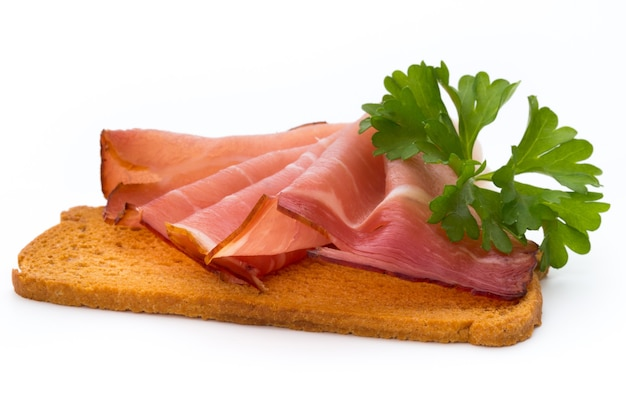 Ham sliced sausage isolated on white surface. Premium Photo