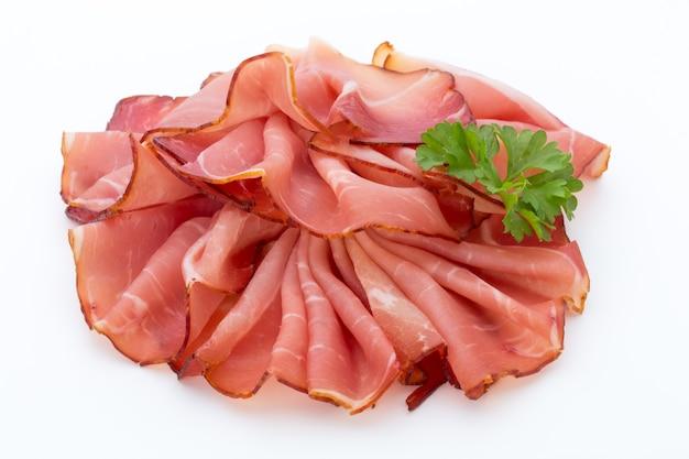 Ham sliced sausage isolated on white surface. Premium Photo