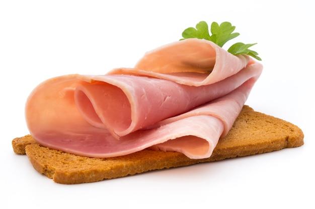 Ham sliced sausage on a white surface Premium Photo