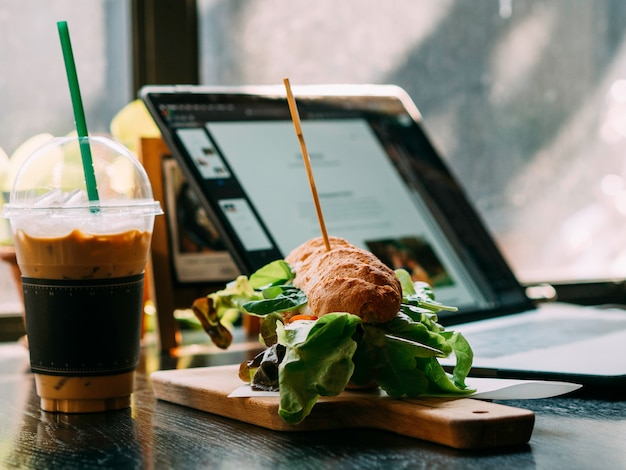 Hamberger fast food with coffee in the restaurant Premium Photo