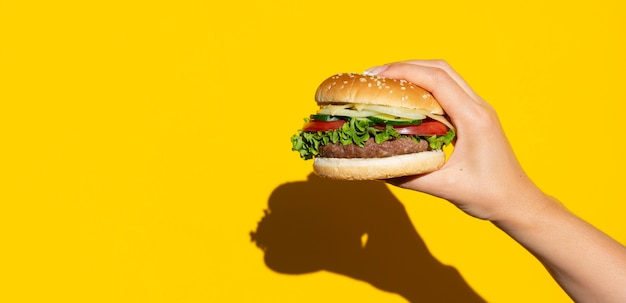 Hamburger in front of yellow background Free Photo