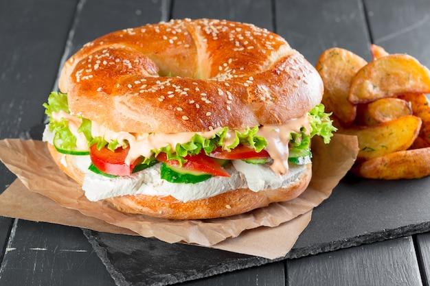 Hamburger with fries on a slate plate Premium Photo