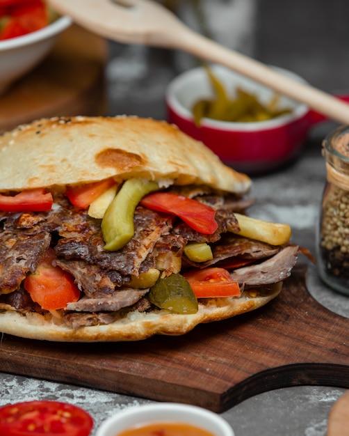 Hamburger with kebab meat, tomato and cucumber Free Photo