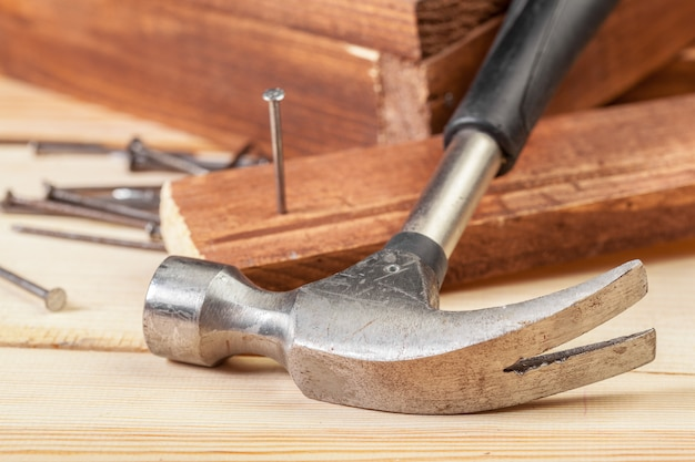 Hammer and nails on wood background Premium Photo
