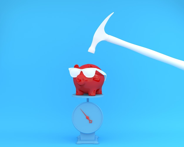 Hammer which is raised above a piggy banks red Premium Photo