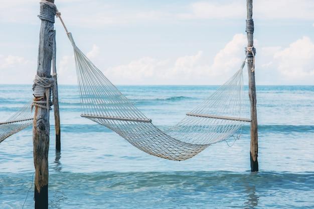 Hammock on beach of thailand. Premium Photo