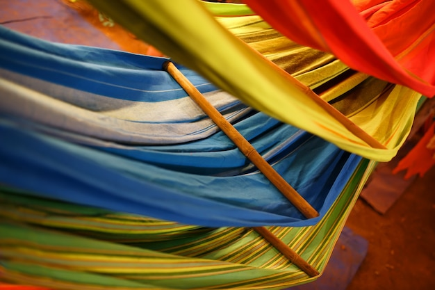 Hammocks of different colors, colors of the rainbow on the night market in goa Premium Photo