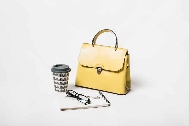 Hand bag and coffee composition Free Photo
