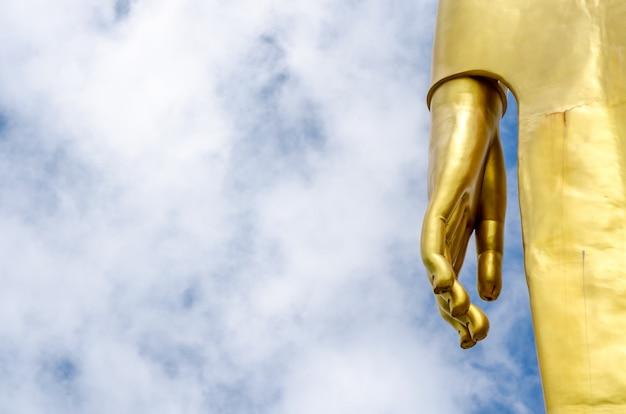 Hand of buddha statue on blue sky Premium Photo