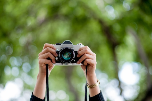 Hand and camera shots photography concept with copy space Premium Photo