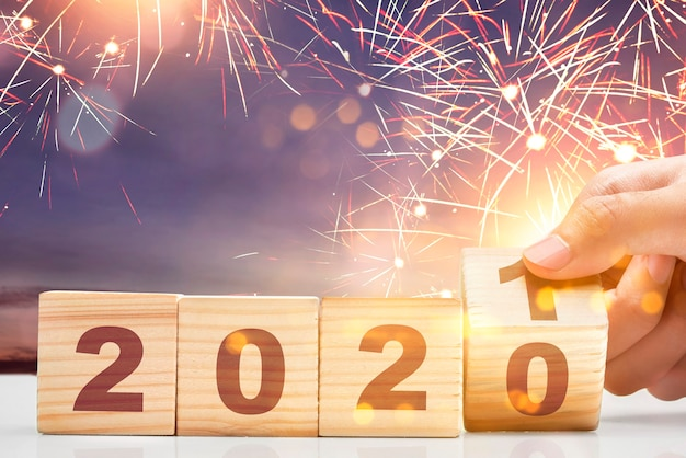 Hand changes the wooden cube from 2020 to 2021. happy new year 2021 Premium Photo