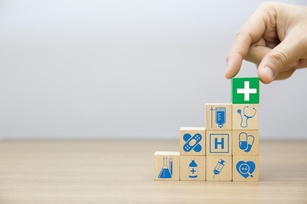 Hand choose medical and health on wood blocks. Premium Photo