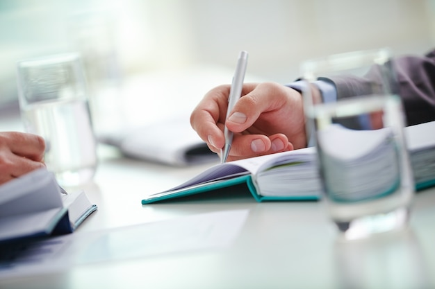 Hand close-up of executive holding a pen Free Photo