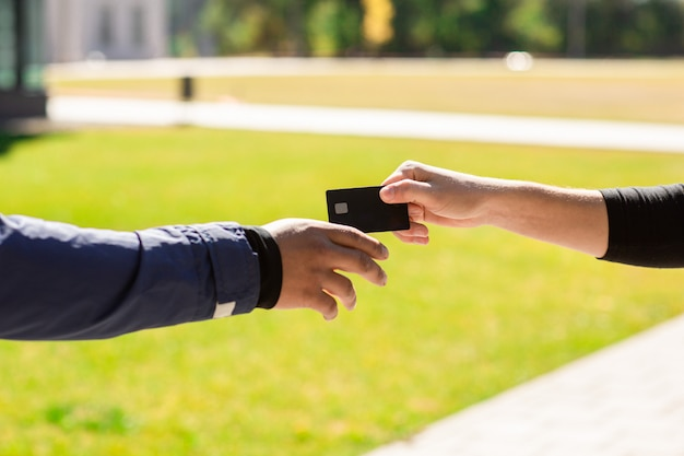 A hand close up with bank credit plastic card. Premium Photo